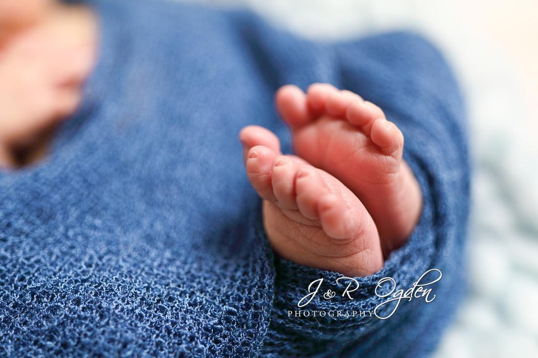 Newborn baby wrapped in chunky blanket - Bangor Maine