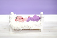 Sleepy Newborn in bed Photography - Bangor Region