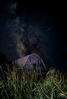 Perseid meteor shower over an old barn and Galactic Core