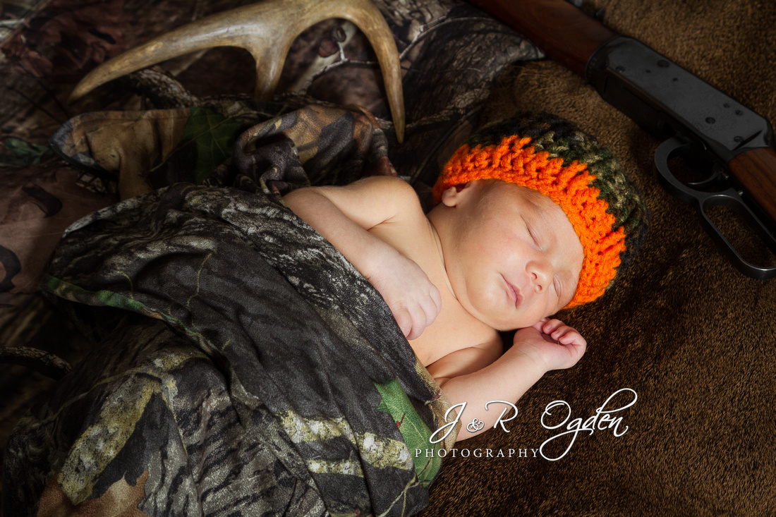 Newborn in camo, deer hide and antlers with rifle portrait - Bangor, ME
