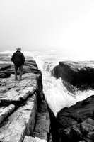 Man overlooking the ocean waves at Schoodic Point
